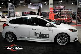 Ford Focus At Sema Trickrides Sema Customcars Aftermarketaccessories Trickyourride Wheel Motor Hood Car Auto Cars Tire Ford Focus Large Cars Ford