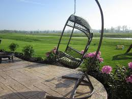 outdoor hanging furniture. Outdoor Garden With Hanging Egg Chair Made From Wooden Material Hangs Beautifully Outside There Furniture