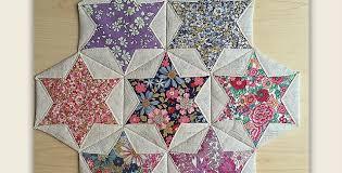 Folded Hexagon Stars Make a Pretty Table Mat - Quilting Digest & Folded Hexagon Stars Adamdwight.com