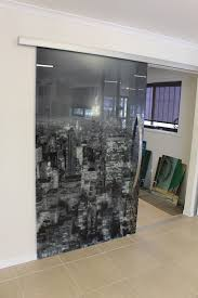 cowdroy sliding doors underneath staircase frameless hinged door with frosted glass