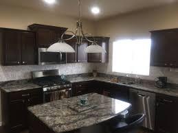 Modern kitchen Dark cabinets dark quartz countertops and DYI