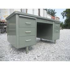 image of vintage steelcase metallic green metal tanker desk