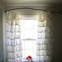 Hang curtains from a branch - and LOTS of other creative, inexpensive  curtain rod ideas