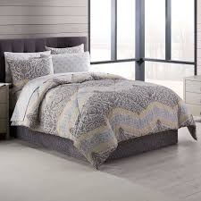 adorned with an elaborate fl and damask design in dark grey and light grey with yellow accents the beautiful bedding