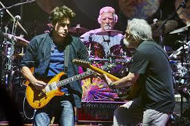 john mayer bill kreutzmann and bob weir of dead company play during a concert