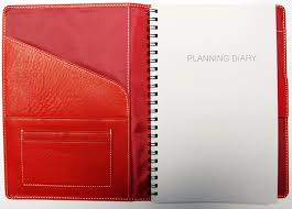 red classic leather planner with planning diary