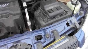 How to Access Battery on 2008 Chevy Equinox LS 3 - YouTube