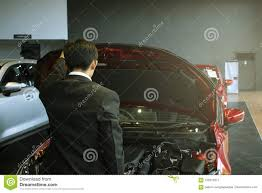 asian man open door car with technology engine on blurry background for automotive or maintenance