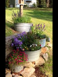 Galvanized metal tubs filled with flowers