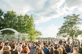 an outdoor ceremony at the chesapeake bay beach club by washington dc wedding photographer adam mason