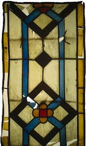 stained glass panel fragment with an architectural pattern