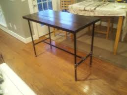 reclaimed wood and black iron pipe table black iron pipe table