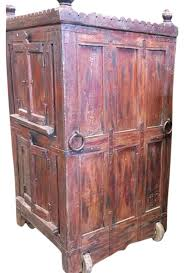 armoire furniture antique. consigned antique armoire furniture vintage indian red cabinet on wheel rusticarmoiresand