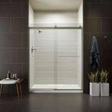 frameless sliding shower door in matte nickel with