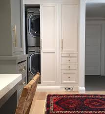 Concealed stacked laundry | Shea McGee Design | Laundry Room ...