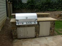 stacked stone grilling station with fridge