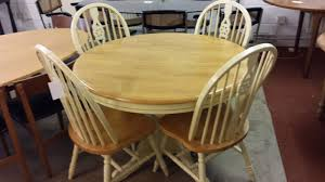 round pine extending table with 4 arched back chairs