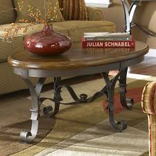 here s another rich wood top coffee table with a metal frame the thin construction keeps tuscan