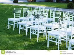 Outdoor wedding furniture Outdoor Seating Area White Chairs At The Outdoor Wedding Ceremony Green Grass Background Portalstrzelecki White Chairs At The Outdoor Wedding Ceremony Green Grass Background
