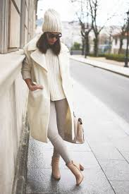wool beanie with sweater and tan jeans and cream peacoat