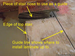 i m using a piece of stair nose to determine where to stop the laminate