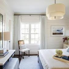 two tier round linen shade pendant over bed