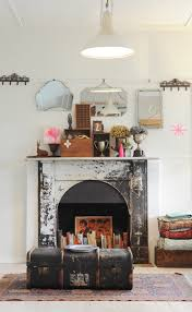 in paula mills home a non operational fireplace becomes a place to display treasured books and objects the key to this idea is painting the interior of