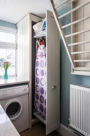 laundry room cabinet with ironing board