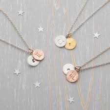 assorted zodiac charm necklaces to demonstrate the diffe colour options
