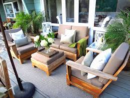 after my outdoor living room this morning after a neutral tone it down makeover as i let my teak furniture weather and go gray above