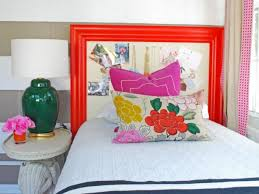 Eclectic Girl's Bedroom With Red Cork Frame Headboard