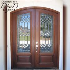 leaded beveled and textured glass can be found in this pair of double doors