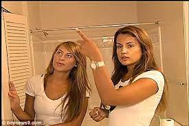 Women wearing slips on hidden camera