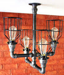 industrial lighting chandelier. Industrial Lighting Chandelier This Lovely Has Four Twisted Pipes Fitted With Caged Light Bulbs Modern: