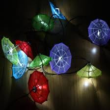 bright and cheerful solar lighting colourful umbrellas illuminate your garden with a bright white glow