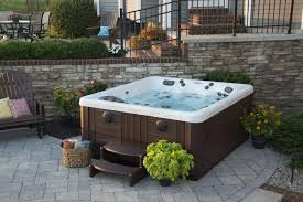 can you put a hot tub on grass your