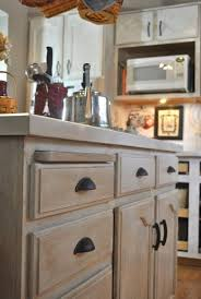 Love this post showing how to take cabinets like mine and lighten them up! White  Wash Cabinets KitchenWhitewash ...