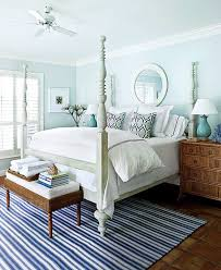 charming bedroom design using blue stripe rug by dash and albert rugs plus canopy bed and