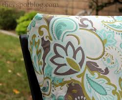 use fabric and a glue to update and recover outdoor furniture cushions