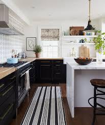 geometric kitchen patterns on back splashes and rugs give kitchens youthful individual looks