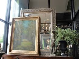 mirrors are like chameleons in the decorating world they take on the look of wver you put with them that s why i like to hang them over a fireplace