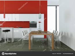 Weiße Moderne Küche In Einem Raum Mit Roten Wand Stockfoto