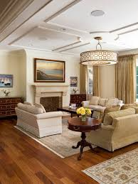 example of a mid sized classic open concept um tone wood floor living room design