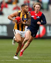 melbourne australia may 04 jarman impey of the hawks is chased by jayden
