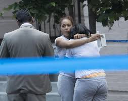 alleged gang member charged in bronx dad s shooting death ny   a w identified as mcqueen s sister is comforted after the shooting