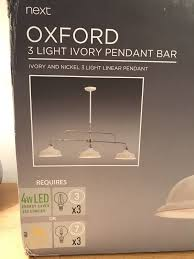 next oxford 3 light ivory pendant bar