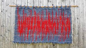 red tapestry woven red blue tapestry
