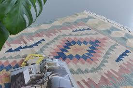 vintage aztec patterned geometric pastel coloured wool kilim rug vinterior