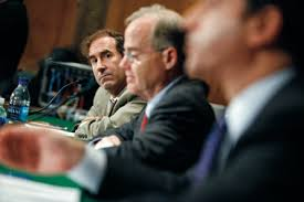 Markopolos testifying before the Senate banking committee, on September 10,  2009, alongside the