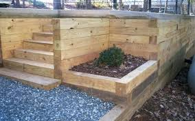 build a wooden retaining wall building a retaining wall with landscape timbers landscape timber retaining wall